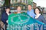Killarney Chamber of Commerce members l-r: Ann Marie O'Shea, Johnny McGuire, Denis McMahon and Kate O'Leary unvail the new flag that will be used when the Oireactasis is held in Killarney next week