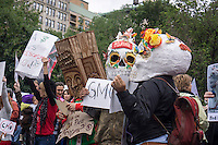 Activists gather in Union Square in New York on Saturday, May 25, 2013 during a worldwide protest against the Monsanto company and genetically modified food. The activists contend that genetically modified foods can lead to serious health problems including cancer and reduce the nutritional content of food. Genetically modified soy and grains make up almost 100 percent of the market notably because of the success of Monsanto's Round-Up Ready seeds and herbicides. (© Richard B. Levine)