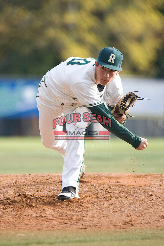 Redmond High School pitcher Dylan Davis follows through on a pitch against Newport High School during a game at Hartman Park on April 30, 2011 in Redmond, Washington.  Photo by Ronnie Allen / Four Seam Images.