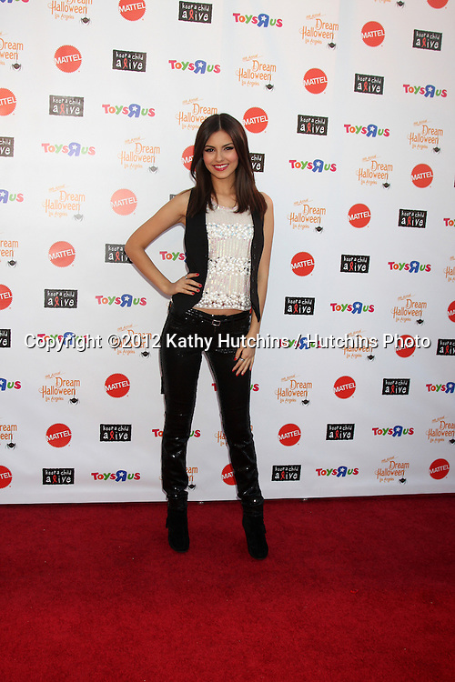 """LOS ANGELES - OCT 27:  Victoria Justice arrives at """"Keep A Child Alive Presents 2012 Dream Halloween Los Angeles"""" at Barker Hanger on October 27, 2012 in Santa Monica, CA"""