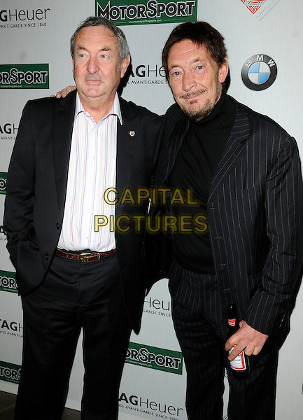 NICK MASON & CHRIS REA .At the Motor Sport Hall of Fame Induction, The Roundhouse, Chalk Farm, London, England, UK, .15th February 2011..half length  black suit white shirt beer bottle drink .CAP/CAN.©Can Nguyen/Capital Pictures.