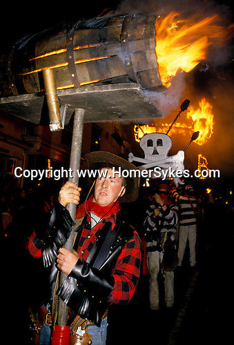 'BONFIRE SOCIETIES, LEWES SUSSEX', ANNUALLY ON 5TH NOVEMBER. BURNING BARRELS ARE CARRIED BY SOCIETY MEMBERS ALONG THE TORCH- LIT PARADE