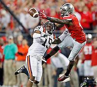 Ohio State Buckeyes running back Dontre Wilson (2) comes up with the one handed catch against Virginia Tech Hokies cornerback Chuck Clark (19) during the 2nd quarter of their game in Ohio Stadium on September 6, 2014.  (Dispatch photo by Kyle Robertson)