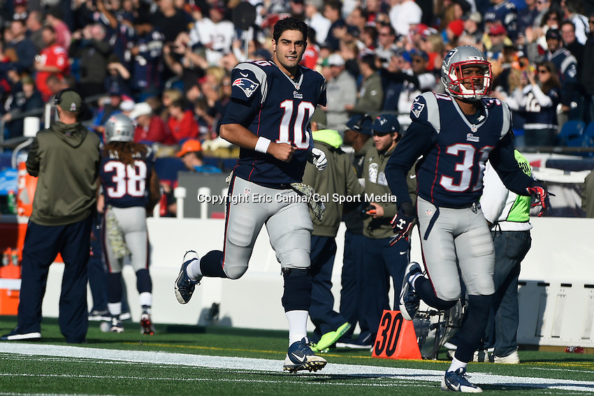 November 23, 2014 - Foxborough, Massachusetts, U.S.- New England Patriots quarterback Jimmy Garoppolo (10) runs onto the field at the NFL game between the Detroit Lions and the New England Patriots held at Gillette Stadium in Foxborough Massachusetts. The Patriots defeated the Lions 34-9. Eric Canha/CSM