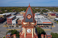 The central clock tower houses a four-faced Seth Thomas Clock Company clock and a 900-pound bell. The mansard roof of the courthouse is characteristic of Second Empire design.