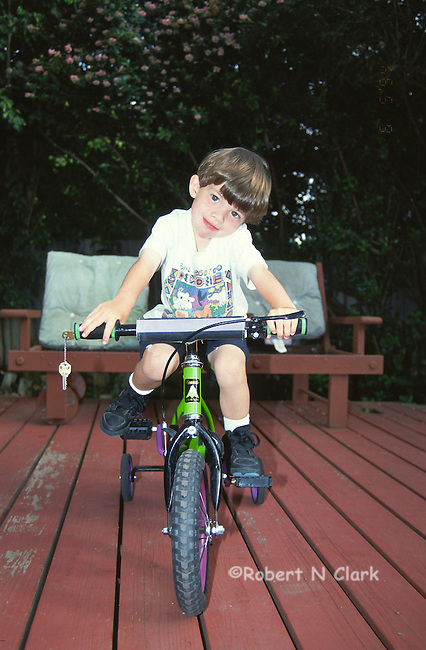 Boy on first bike with training wheels