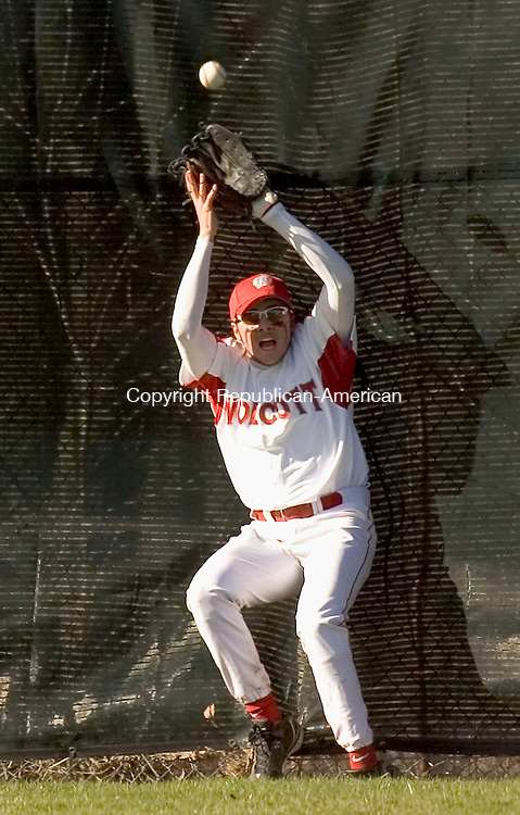 WOLCOTT, CT- 19 APRIL 2007-041907JS04-Wolcott's Kyle Cleary manages to catch a fly ball after running into the wall during their game against Naugatuck Thursday at Wolcott High School.-- --Jim Shannon / Republican-American