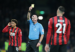 Referee Lee Mason shows Bournemouth's Diego Rico a yellow card during the Premier League match at the Tottenham Hotspur Stadium, London. Picture date: 30th November 2019. Picture credit should read: Paul Terry/Sportimage
