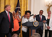 Alice Johnson, a convicted drug trafficker who served 21 years in prison, and who was pardoned after the intervention of Kim Kardashian, makes remarks as United States President Donald J. Trump, left, looks on during the 2019 Prison Reform Summit and First Step Act Celebration in the East Room of the White House in Washington, DC on Monday, April 1, 2019.<br /> Credit: Ron Sachs / CNP