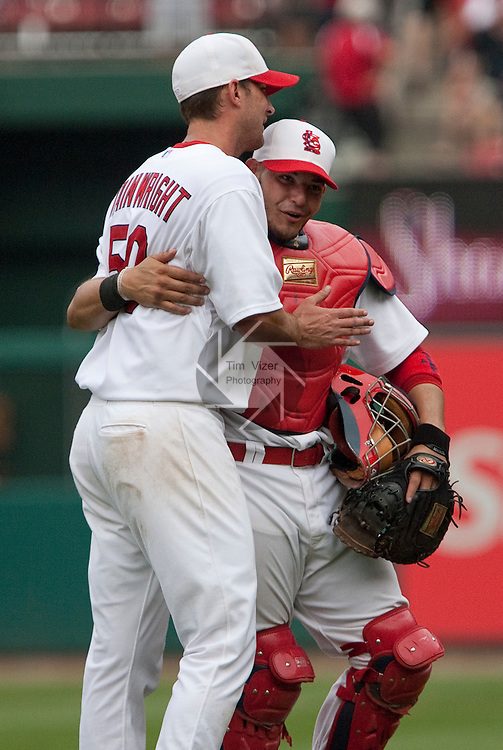 July 4, 2010          St. Louis Cardinals catcher Yadier Molina (4, right) and St. Louis Cardinals starting pitcher Adam Wainwright (50) congratulate each other after the St. Louis Cardinals defeated the Milwaukee Brewers 7-1 in the final game of a four-game homestand at Busch Stadium in downtown St. Louis, MO on Sunday July 4, 2010.