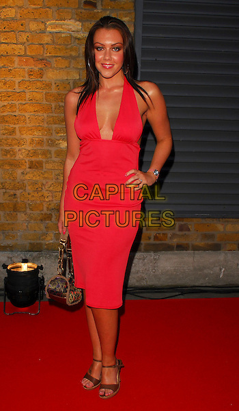 MICHELLE HEATON.OK! Magazine - private 10th anniversary party, Old Billingsgate, London, UK..May 10th, 2006.Ref: CAN.full length red dress hand on hip plunging neckline.www.capitalpictures.com.sales@capitalpictures.com.©Capital Pictures