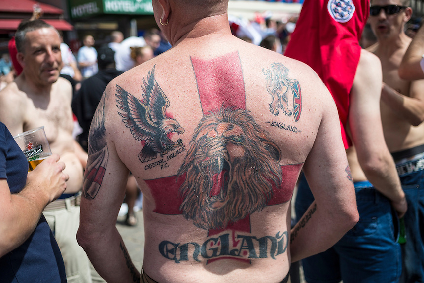 One England fan shows off his tattoos in the pre-match build up in Marseille old town before the game<br /> <br /> Photographer Craig Mercer/CameraSport<br /> <br /> International Football - 2016 UEFA European Championship - Group B - England v Russia - Saturday 11th June 2016 - Stade Velodrome, Marseille - France <br /> <br /> World Copyright &copy; 2016 CameraSport. All rights reserved. 43 Linden Ave. Countesthorpe. Leicester. England. LE8 5PG - Tel: +44 (0) 116 277 4147 - admin@camerasport.com - www.camerasport.com
