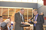 Erik Lindbergh (right), grandson of aviator Charles Lindbergh, and Perry Los Kamp (left) Past President of Mustang & Shelby Club of Long Island, at 85th anniversary celebration of Lindbergh's grandfather's historic solo flight across Atlantic, on Saturday May 19, 2012, at Cradle of Aviation museum, Long Island, New York.