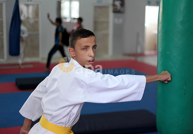 A visually impaired Palestinian boy take parts in a Karate class at al-Masthal club in Gaza city Sep. 06, 2015. The training is held twice a week by the club to lift the morale of the children, trainers said. Photo by Ashraf Amra
