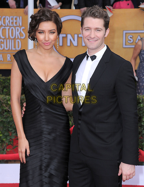 Renee Puente & Matthew Morrison.Arrivals at the 19th Annual Screen Actors Guild Awards at the Shrine Auditorium in Los Angeles, California, USA..27th January 2013.SAG SAGs half length black white dress shirt tuxedo couple .CAP/DVS.©DVS/Capital Pictures.