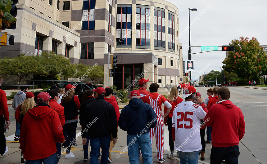 Badger fans cross Brooks Street in front of the University of Wisconsin School of Business on Saturday, October 3, 2015 in Madison, Wisconsin