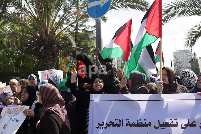 Palestinian women shout slogans as they march in Gaza City on March 05, 2013 during a rally for the International Women's Day which is celebrated worldwide on March 8. Photo by Ashraf Amra