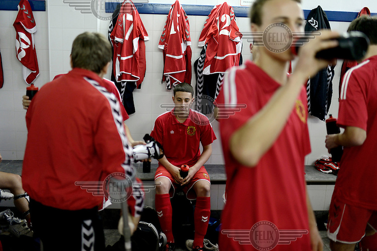 Players from the Gibraltarian under-17 national team  get changed prior to a match against Northern Ireland played in March 2013. AAlthough the United Nations doesn't recognise Gibraltar as an independent country, UEFA has recognised it and has granted the British Overseas Territory full UEFA membership.