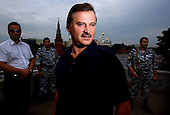 Russian billionaire Sergei Veremeenko poses in front of the Kremlin in Moscow, Russia, in front of his armed bodyguards.