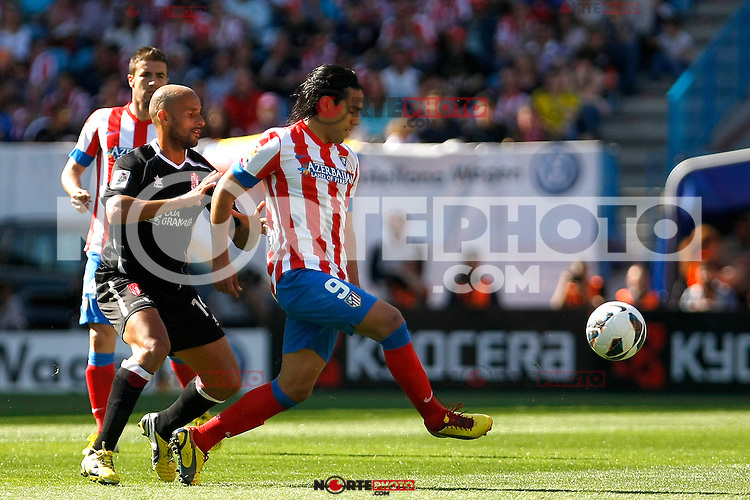 Atletico's Falcao and Granada's Mikel Rico during La Liga BBVA match. April 14, 2013.(ALTERPHOTOS/Alconada)