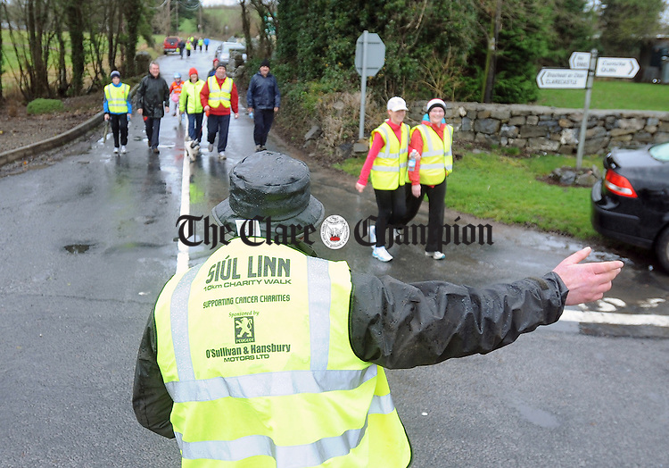 Jim Bob Donnelly keeping the entrants on the right track through Doora during the Siúl Linn 10K Charity Walk in support of cancer charities at the weekend. Photograph by Declan Monaghan