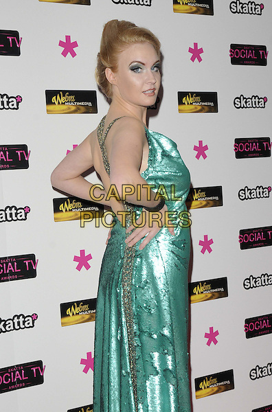Kitty Brucknell.attended Social TV Awards 2013, BAFTA Headquarters, Piccadilly, London, England..March 27th, 2013.half length green shiny dress hands on hips side looking over shoulder .CAP/CAN.©Can Nguyen/Capital Pictures.