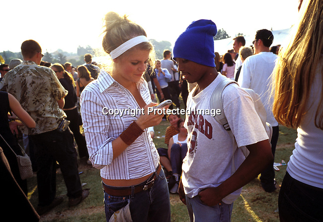 dipptee00042 .JOHANNESBURG, SOUTH AFRICA - MAY 28: Unidentified youths socializing at a yearly youth festival on May 28, 2002 in Auckland Park a suburb in Johannesburg, South Africa. After eight years into democracy the white youth in the country has to compete with a growing black middleclass and elite about jobs and prosperity. Some whites that were rewarded in the old system have problems to adjust to competing and sharing the countryÕs wealth with the black population. .©Per-Anders Pettersson/iAfrika Photos...