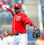 25 April 2010: Washington Nationals' infielder Cristian Guzman warms up prior to a game against the Los Angeles Dodgers at Nationals Park in Washington, DC. The Nationals shut out the Dodgers 1-0 to take the rubber match of their 3-game series. Mandatory Credit: Ed Wolfstein Photo