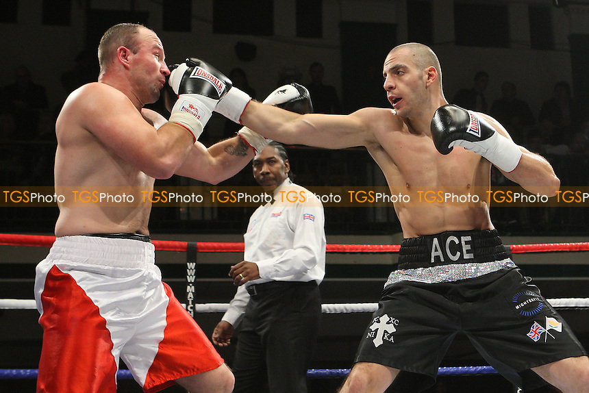Andreas Evangelou (black shorts) defeats Robert Studzinski in a Light-Heavyweight boxing contest at York Hall, Bethnal Green, promoted by Matchroom Sports - 28/01/12 - MANDATORY CREDIT: Gavin Ellis/TGSPHOTO - Self billing applies where appropriate - 0845 094 6026 - contact@tgsphoto.co.uk - NO UNPAID USE.