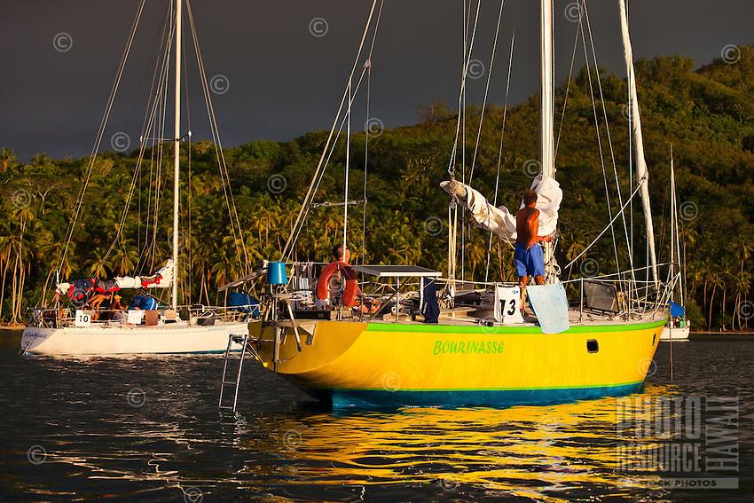 Yachts Bourinasse and Windfall anchored off Bora Bora at sunset