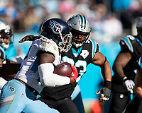 CHARLOTTE, NC - NOVEMBER 3: Derrick Henry #22 of the Tennessee Titans runs with the ball during a game between Tennessee Titans and Carolina Panthers at Bank of America Stadium on November 3, 2019 in Charlotte, North Carolina.