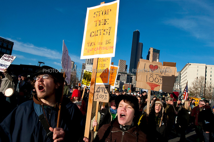 12/12/2011--Seattle, WA..Occupy Seattle, an off-shoot of the Occupy Wall Street movement, organized a protest Monday, December 12th, to block the Port of Seattle as part of a West Coast coordinated action in San Diego, Los Angeles, Oakland, Portland, Tacoma, Vancouver, B.C., and Houston. The 'Port shut down' protest was not endorsed by any of the maritime unions including the International Longshore and Warehouse Union (ILWU) which has been in a bitter labor despite in Westport, Washington...Here: the protesters move through downtown Seattle from Westlake Park on their way to the Port of Seattle...©2011 Stuart Isett. All rights reserved.