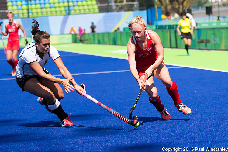 Jill Witmer #10 of United States is tackled by Julia Muller #28 of Germany during USA vs Germany in a women's quarterfinal game at the Rio 2016 Olympics at the Olympic Hockey Centre in Rio de Janeiro, Brazil.