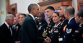 United States President Barack Obama shakes hands with military service members at the Pentagon in Washington, D.C. on Wednesday, October 6, 2014.<br /> Credit: Dennis Brack / Pool via CNP