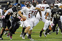 25 October 2011:  FIU linebacker Gregory Hickman (55) and defensive back Jose Cheeseborough (27) pressure Troy quarterback Corey Robinson (6) in the second quarter as the FIU Golden Panthers defeated the Troy University Trojans, 23-20 in overtime, at FIU Stadium in Miami, Florida.