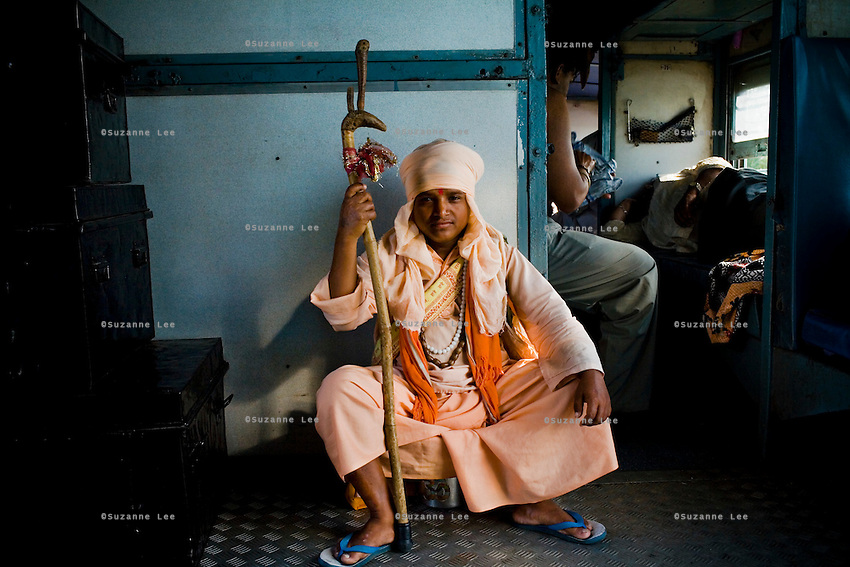 A travelling sadhu rides the Himsagar Express 6318 for free from Dhuri Junction Stn. to Sangrur Stn., Punjab on 7th July 2009.. .6318 / Himsagar Express, India's longest single train journey, spanning 3720 kms, going from the mountains (Hima) to the seas (Sagar), from Jammu and Kashmir state of the Indian Himalayas to Kanyakumari, which is the southern most tip of India...Photo by Suzanne Lee / for The National