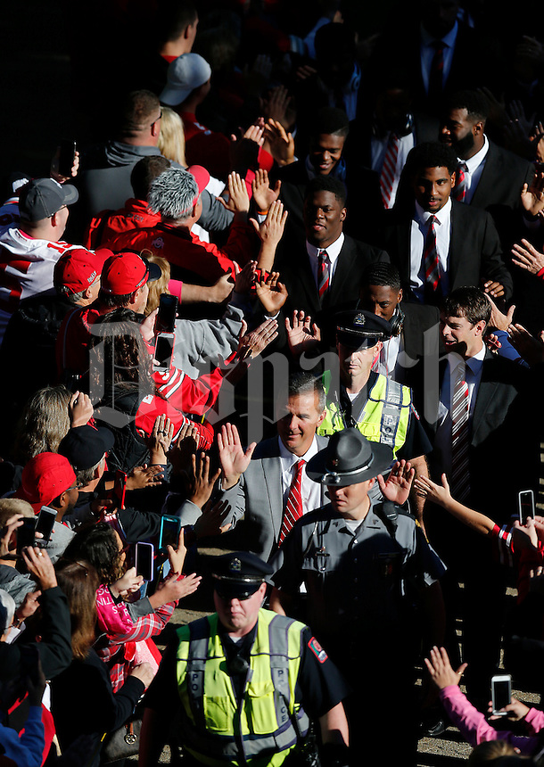 Ohio State Buckeyes head coach Urban Meyer leads the team to Ohio Stadium before the college football game between the Ohio State Buckeyes and the Maryland Terrapins in Columbus, Saturday afternoon, October 10, 2015. (The Columbus Dispatch / Eamon Queeney)