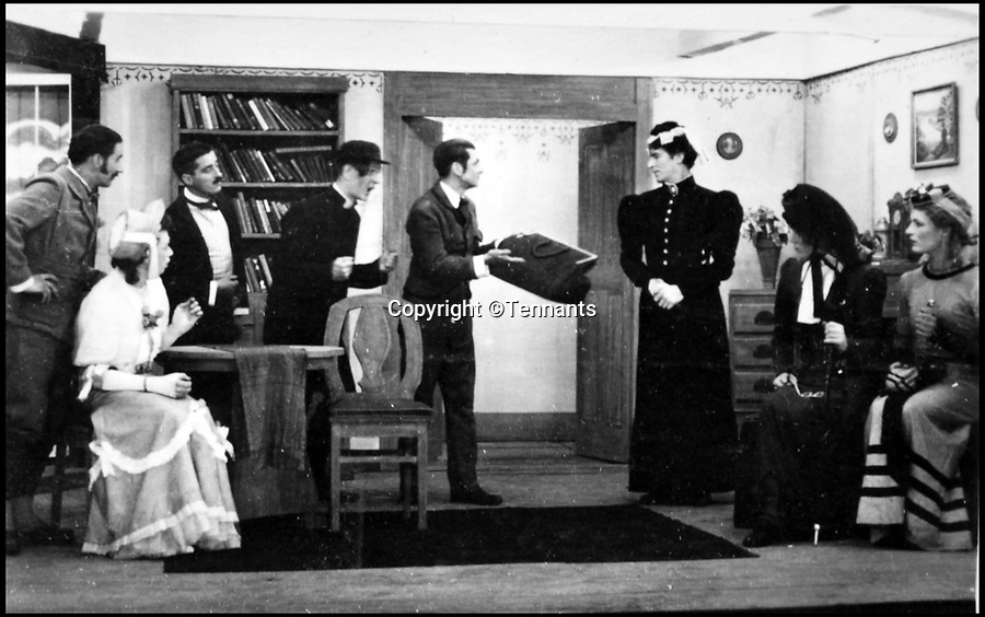 BNPS.co.uk (01202 558833)Pic: Tennants/BNPS<br /> <br /> Bernard Cockcroft playing 'Miss Cecily Cardew' in the play 'The importance of Being Earnest'. (white dress)<br /> <br /> Oh What a Lovely War...<br /> <br /> The extraordinary level of professionalism a group of British soldiers put into their theatre productions at a PoW camp can be revealed in a newly-discovered archive.<br /> <br /> So serious were the am-dram group of Stalag 383 they created a banked earth floor in a barn to form a sloping auditorium that became known as the 'Ofladium'.<br /> <br /> The men bartered their Red Cross parcels with their German guards for materials and props and then spent weeks creating sets that wouldn't look out of place in a West End theatre.<br /> <br /> The sets, costumes, performances and concert programmes were of almost professional standards, with a great deal of time, effort and skill clearly going into creating them.