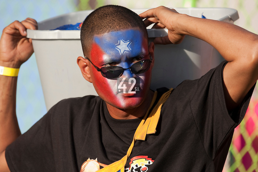 9 March 2009: A vendor is seen with Puerto Rico colors on his face during the 2009 World Baseball Classic Pool D game 4 at Hiram Bithorn Stadium in San Juan, Puerto Rico. Puerto Rico wins 3-1 over Netherlands