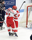 Jenn Wakefield (BU - 9), Kayla Tutino (BU - 8) - The Boston University Terriers defeated the visiting University of Connecticut Huskies 4-2 on Saturday, November 19, 2011, at Walter Brown Arena in Boston, Massachusetts.