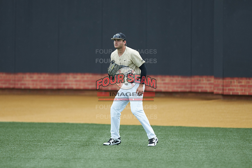 Wake Forest Demon Deacons right fielder Michael Ludowig (22) on defense against the Virginia Cavaliers at David F. Couch Ballpark on May 19, 2018 in  Winston-Salem, North Carolina. The Demon Deacons defeated the Cavaliers 18-12. (Brian Westerholt/Four Seam Images)