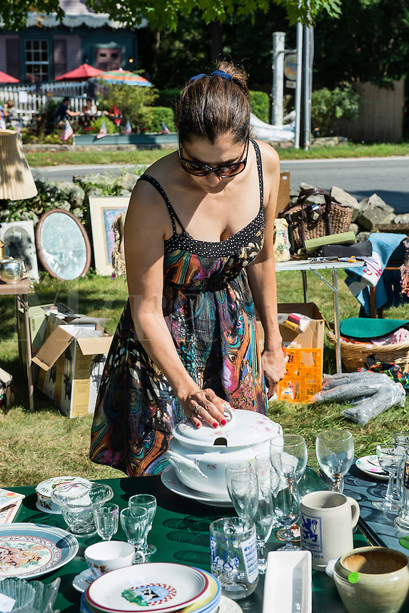 Woman shopping for bargains at a garage sale.