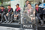 Apr. 19 2010 - BANGKOK, THAILAND: Thai riot police sit on the sidewalk in the Silom financial district in Bangkok Monday. Hundreds of Thai soldiers, including reservists and front line units, and riot police moved into the Silom financial district Monday, not far from the red-shirts' main protest rally site, in Ratchaprasong. The heavy show of force is to prevent the Red Shirts from entering the Silom area. Many of soldiers were greeted as heros by workers in the area, who oppose the Red Shirts.   Photo by Jack Kurtz