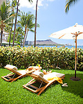 The Halekulani Hotel, the Hawaiian name meaning House Befitting Heaven, located on Waikiki beach in Honolulu, Hawaii offers stunning views of Diamond Head in a historic, secluded and exclusive setting. The Orchid Suite is situated oceanfront with floor-to-ceiling doors opening to private lawns and an open-air trellised lounge.
