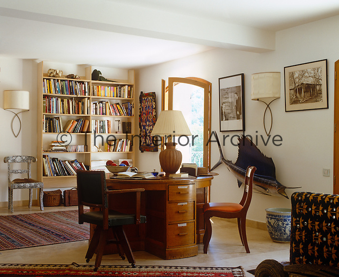 The study has a vintage wooden desk designed for two