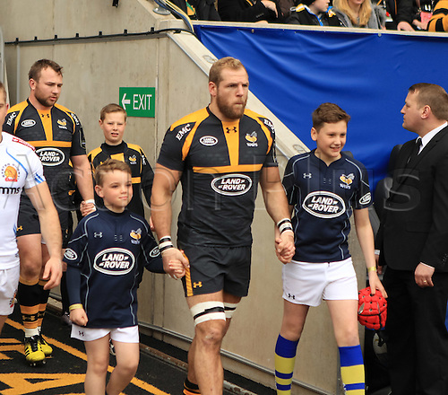 09.04.2016. Ricoh Arena, Coventry, England. European Champions Cup. Wasps versus Exeter Chiefs.  Wasps captain James Haskell  leads out his team accompanied by the match mascots