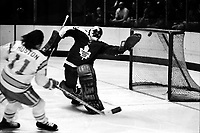 Seals Ron Huston shot on Toronto Maple Leaf goalie Doug Favell (1975 photo/Ron Riesterer)
