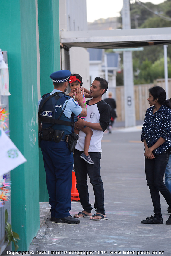 NZ Police youth aid officer Shannon Payne greets mosque visitors outside the Wellington Islamic Centre in Wellington, New Zealand on Tuesday, 19 March 2019. Photo: Dave Lintott / lintottphoto.co.nz