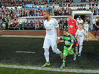 Childr mascot with Ashley Williams before the Barclays Premier League match between Swansea City and Arsenal at the Liberty Stadium, Swansea on October 31st 2015