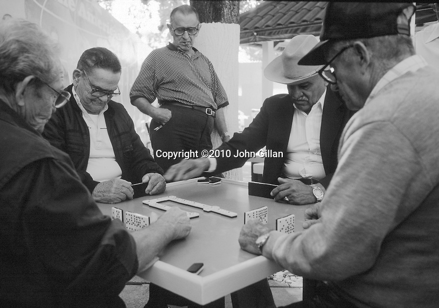 Older men playing dominos outside at Domino Park in Little Havana,Miami